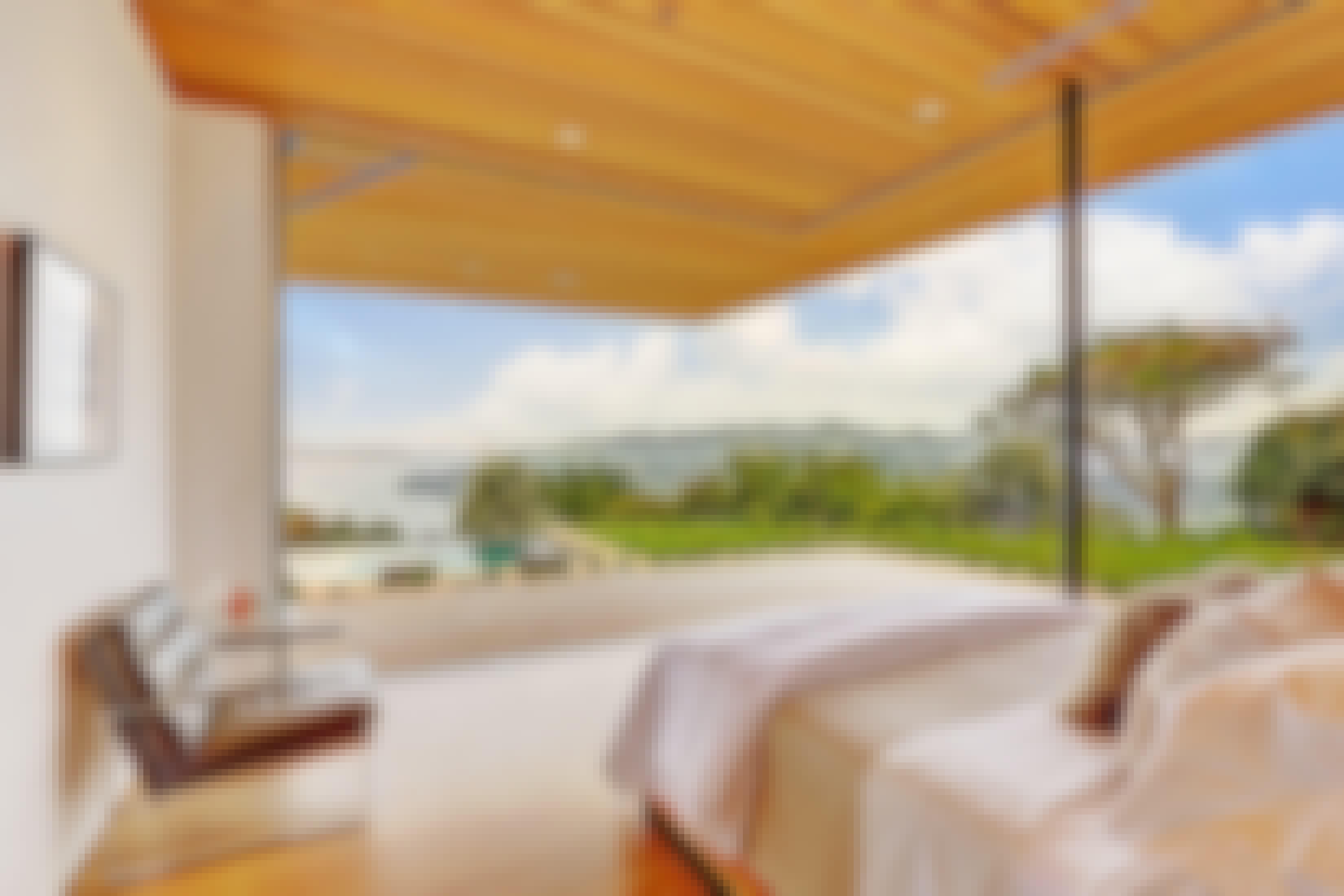 opening-glass-walls-in-bedroom-providing-ocean-view