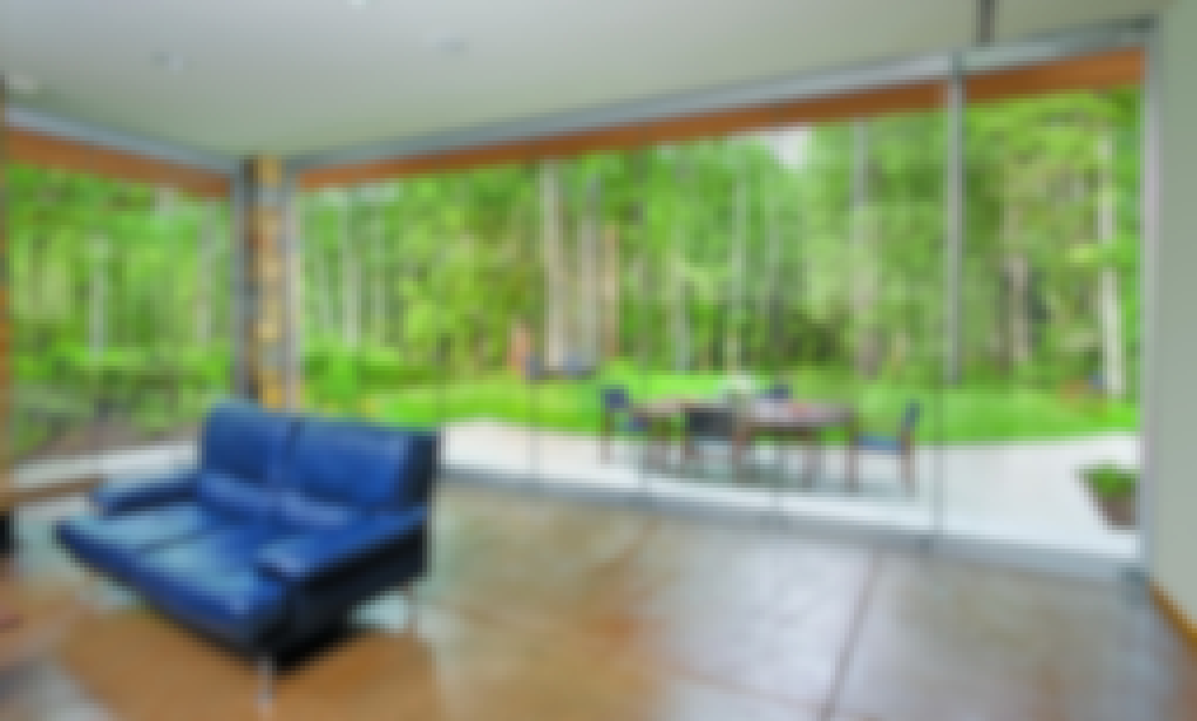 ClimaCLEAR frameless glass walls enclose an indoor/outdoor living space
