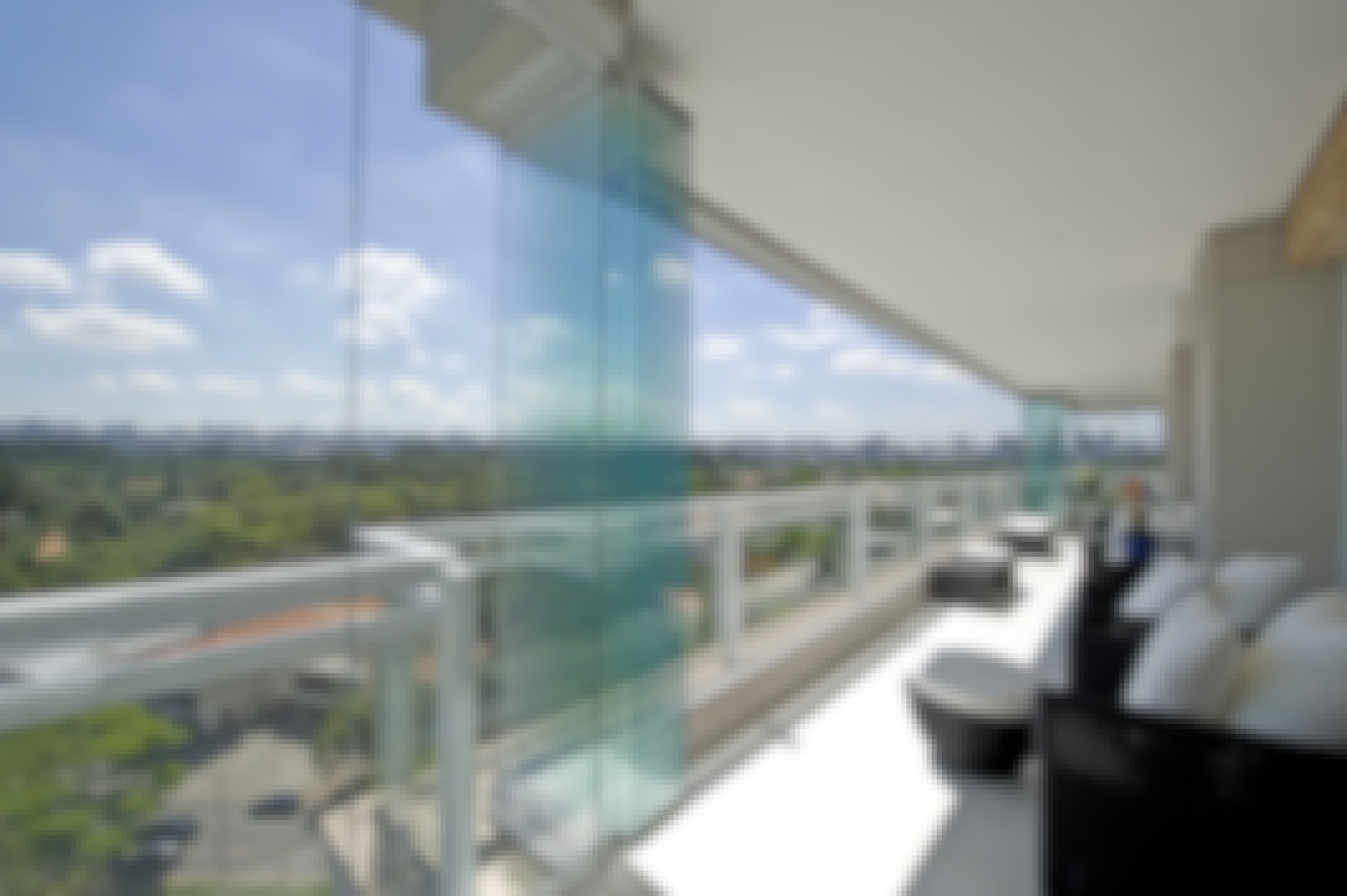 Balcony enclosed with an all glass operable system.