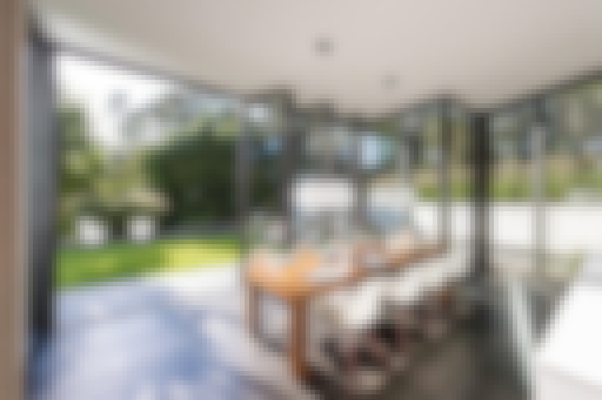 open concept living with folding glass wall to the outdoors
