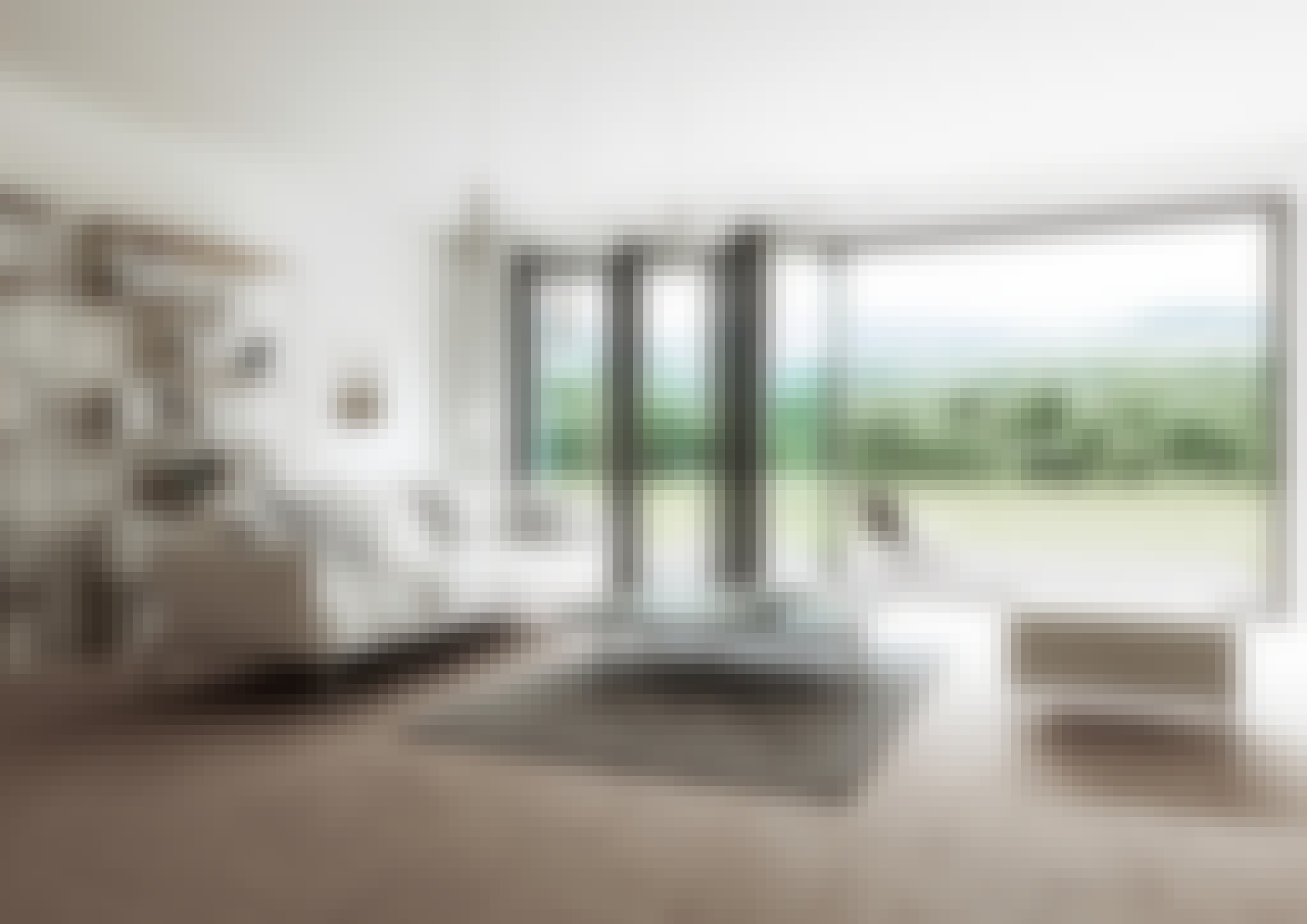 biophilc design prinicples in contemporary home design with folding glass wall