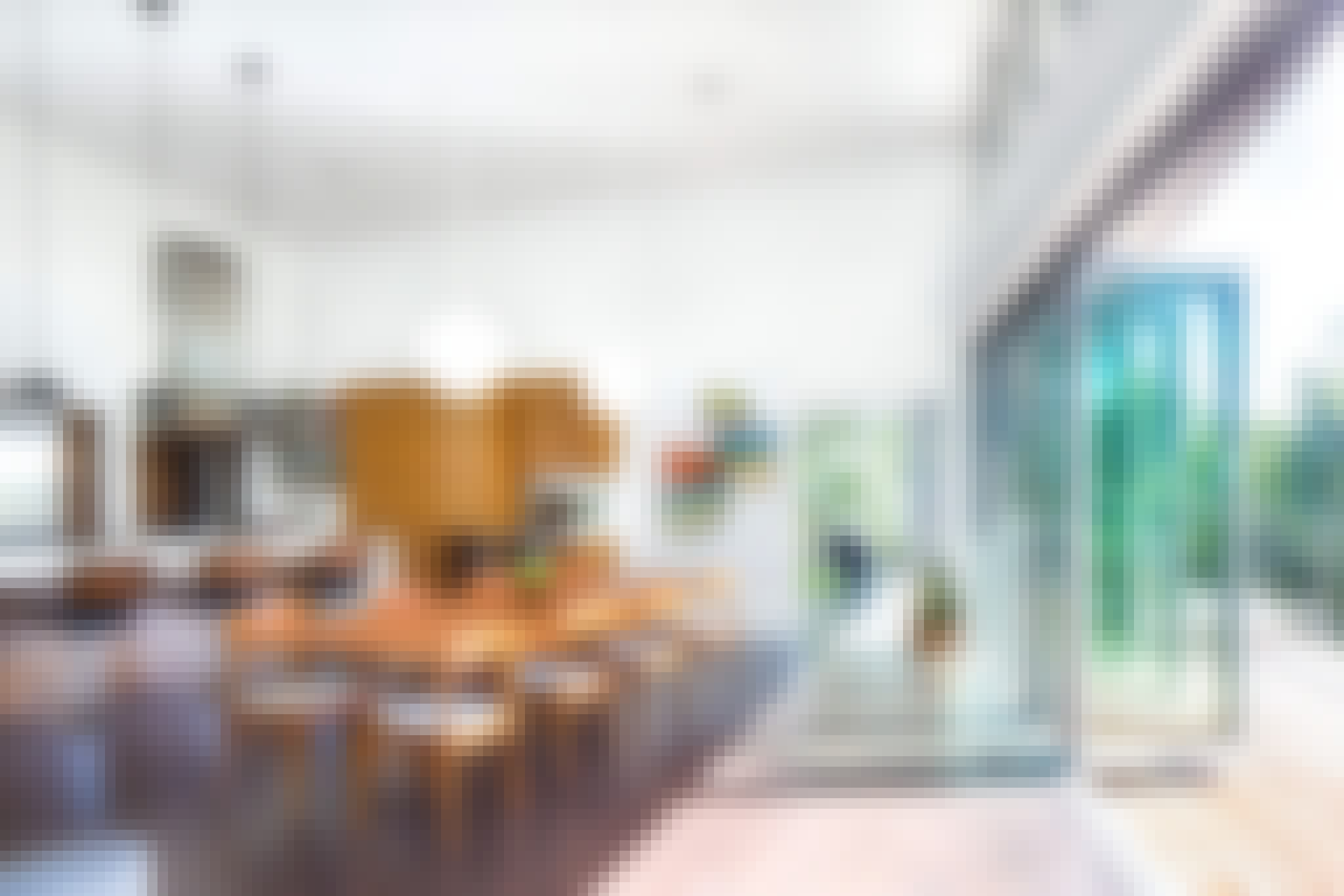 folding glass wall partially open in dining room with hillside view
