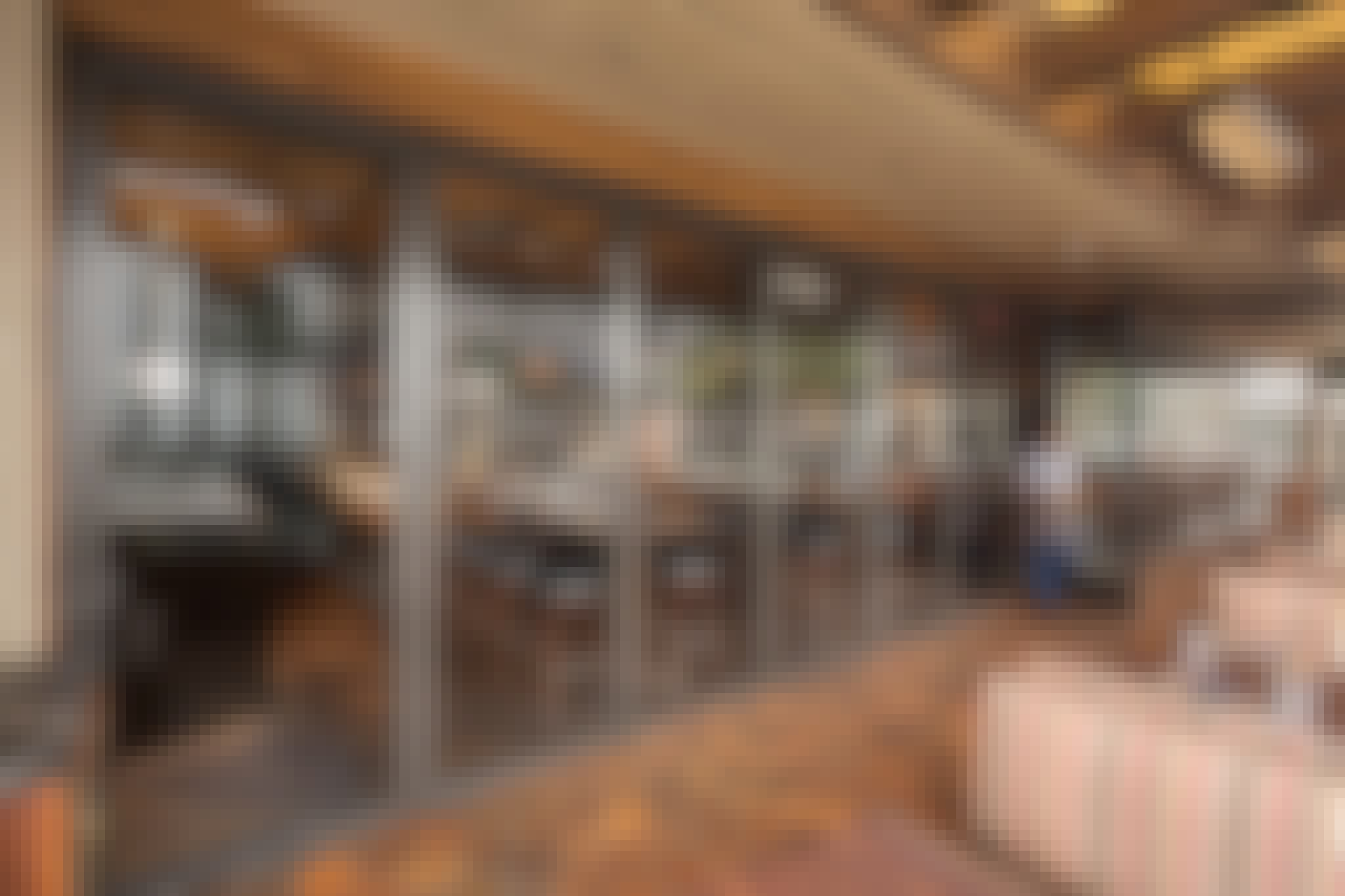 commercial design in restaurant with sliding glass wall and server using swing door