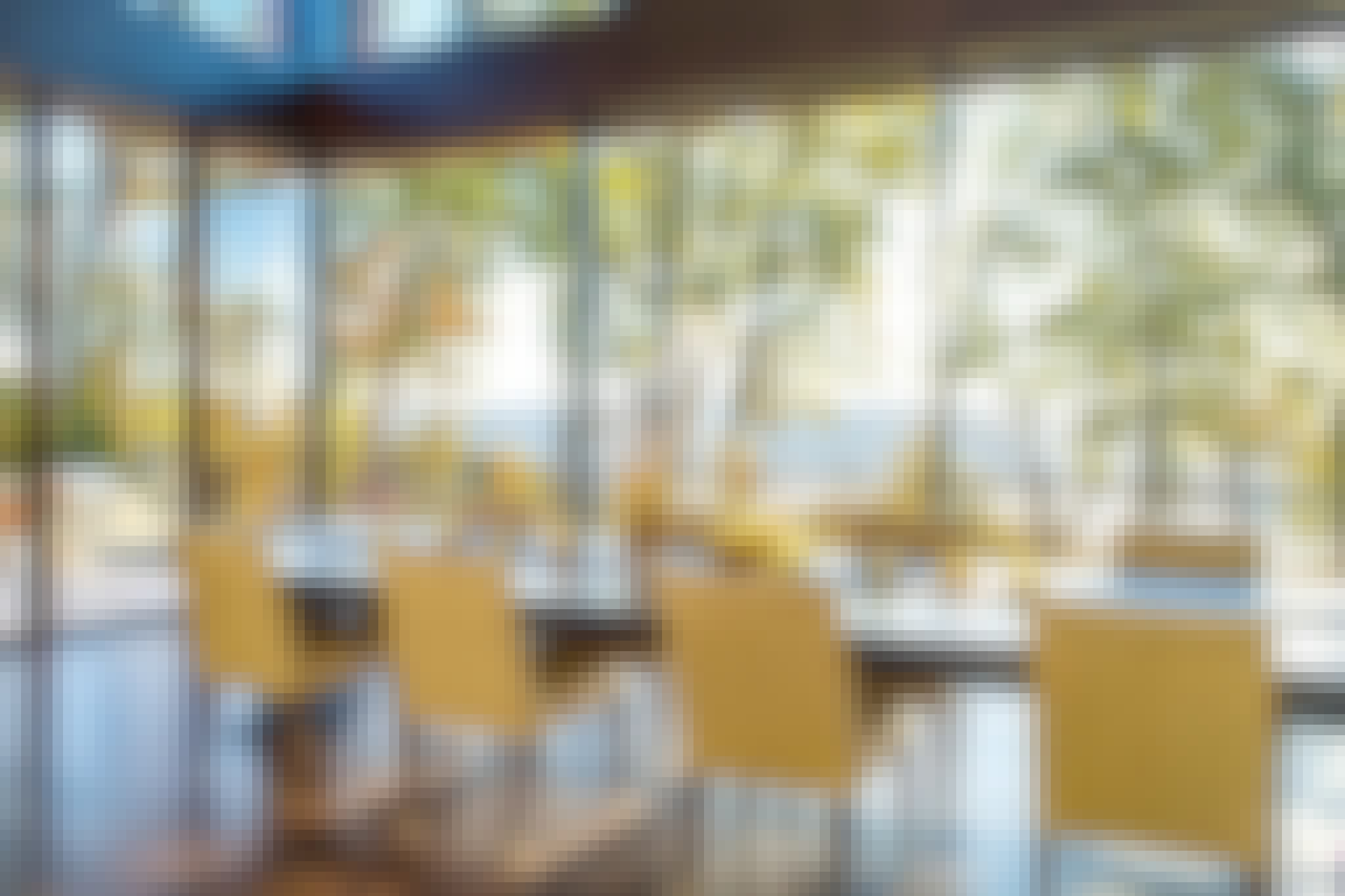 beautiful tree lined view in dining room through cero minimal sliding glass wall