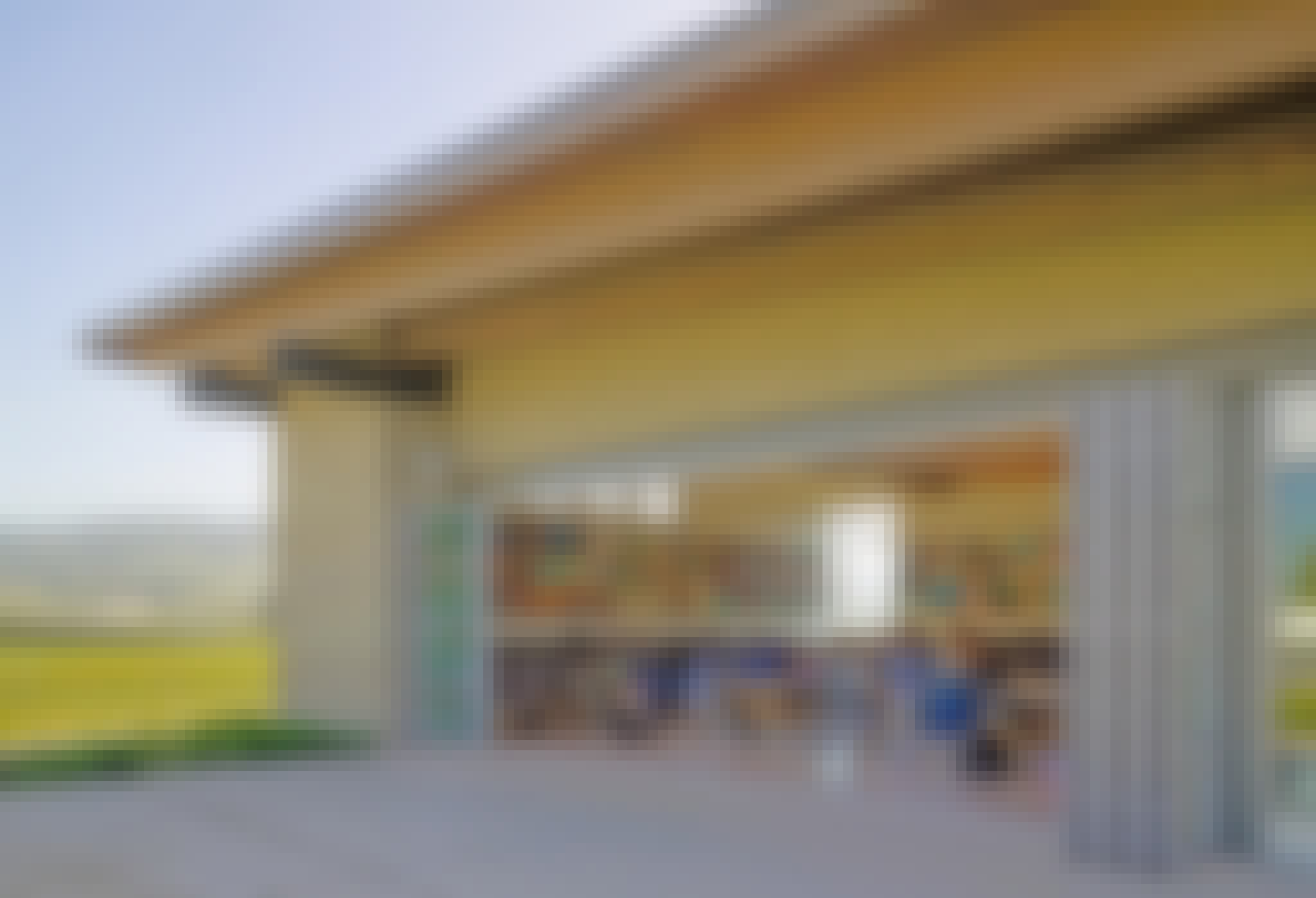 high school classroom with large oping folding wall letting in fresh air and daylight