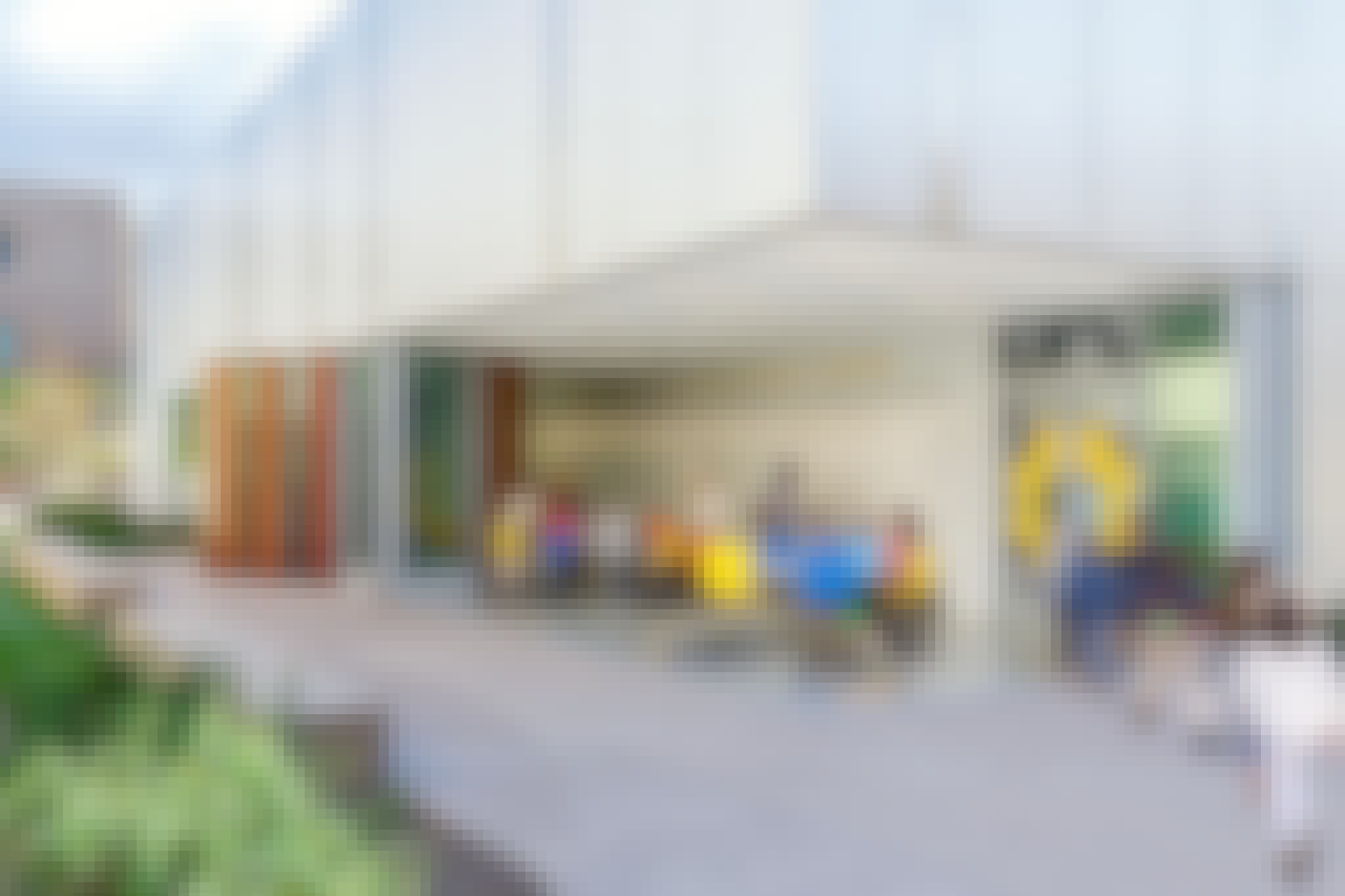 open air classroom with disappearing sliding glass walls with kids in dynamic learning environment