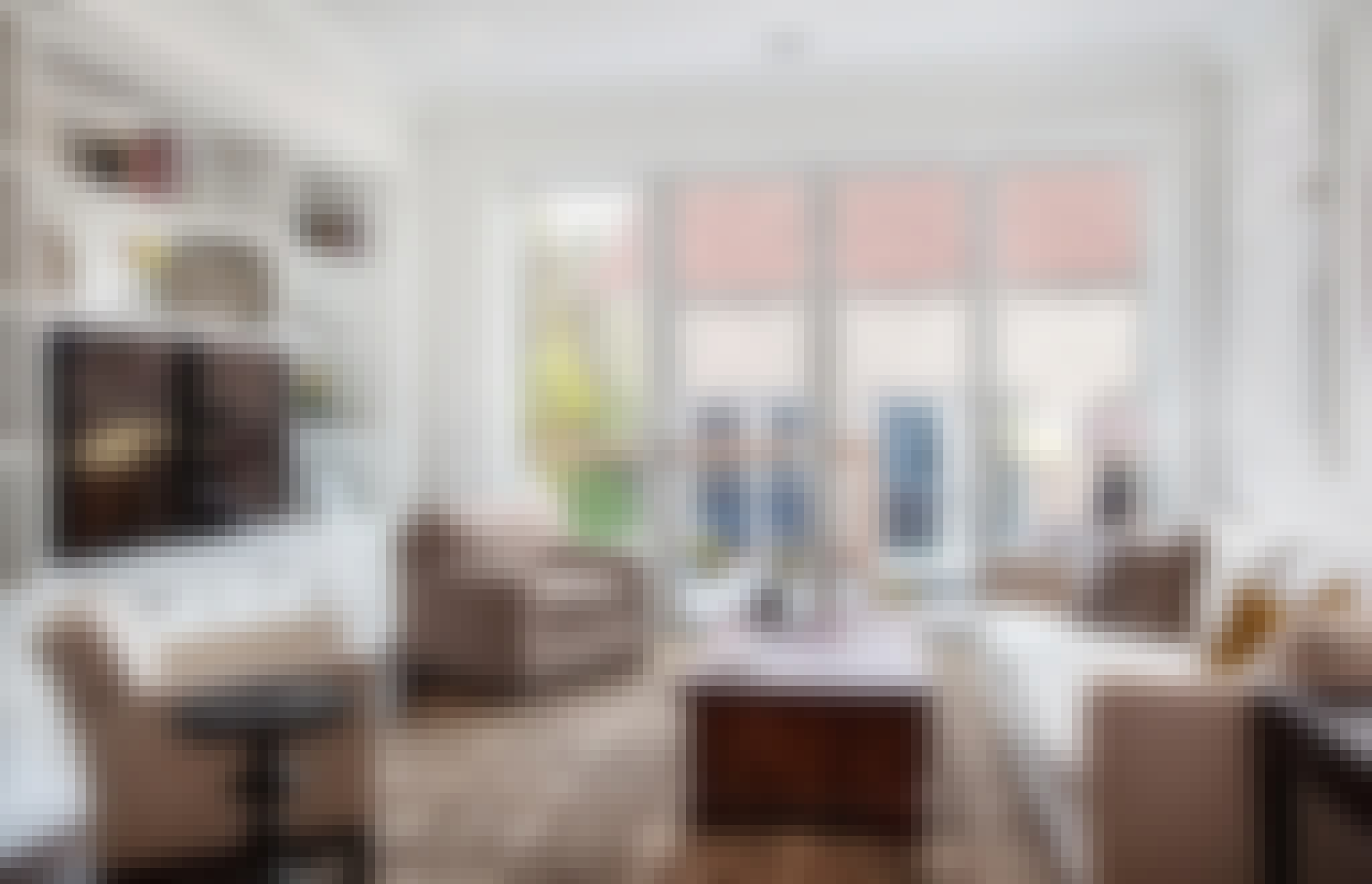 a chicago greystone living room remodeled with folding glass door for lots of daylight