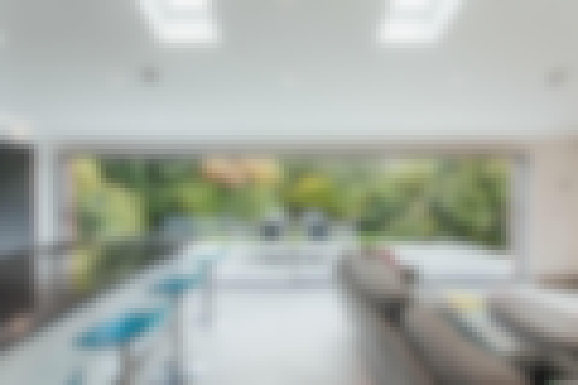 minimal framed sliding glass walls in living room for a modern makeover