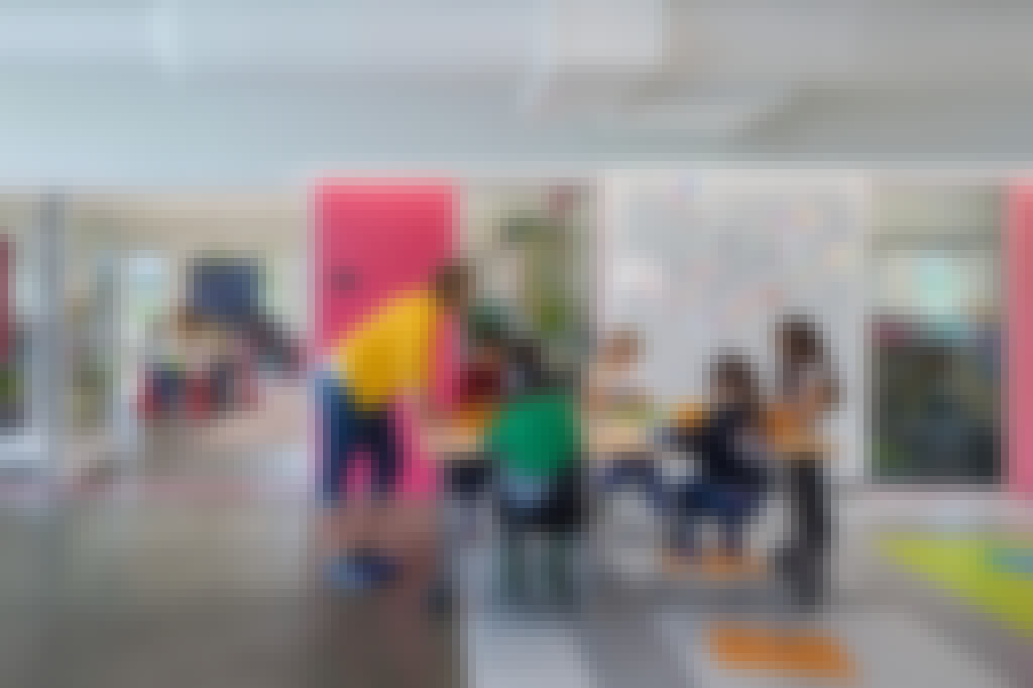 collaborative learning in schools with learning hub and flexible folding glass walls with teacher and kids