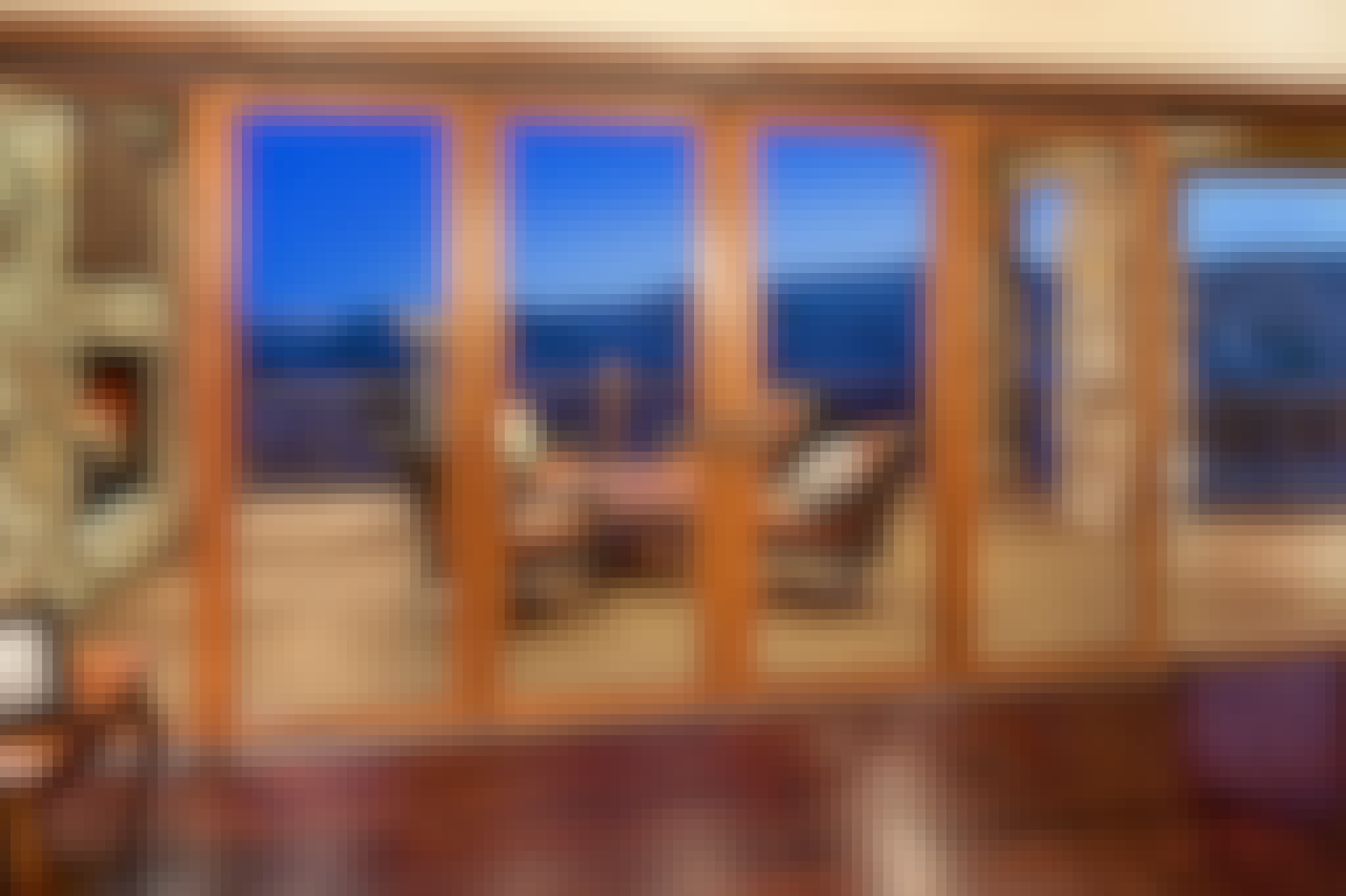 wood sliding glass wall with hillside view