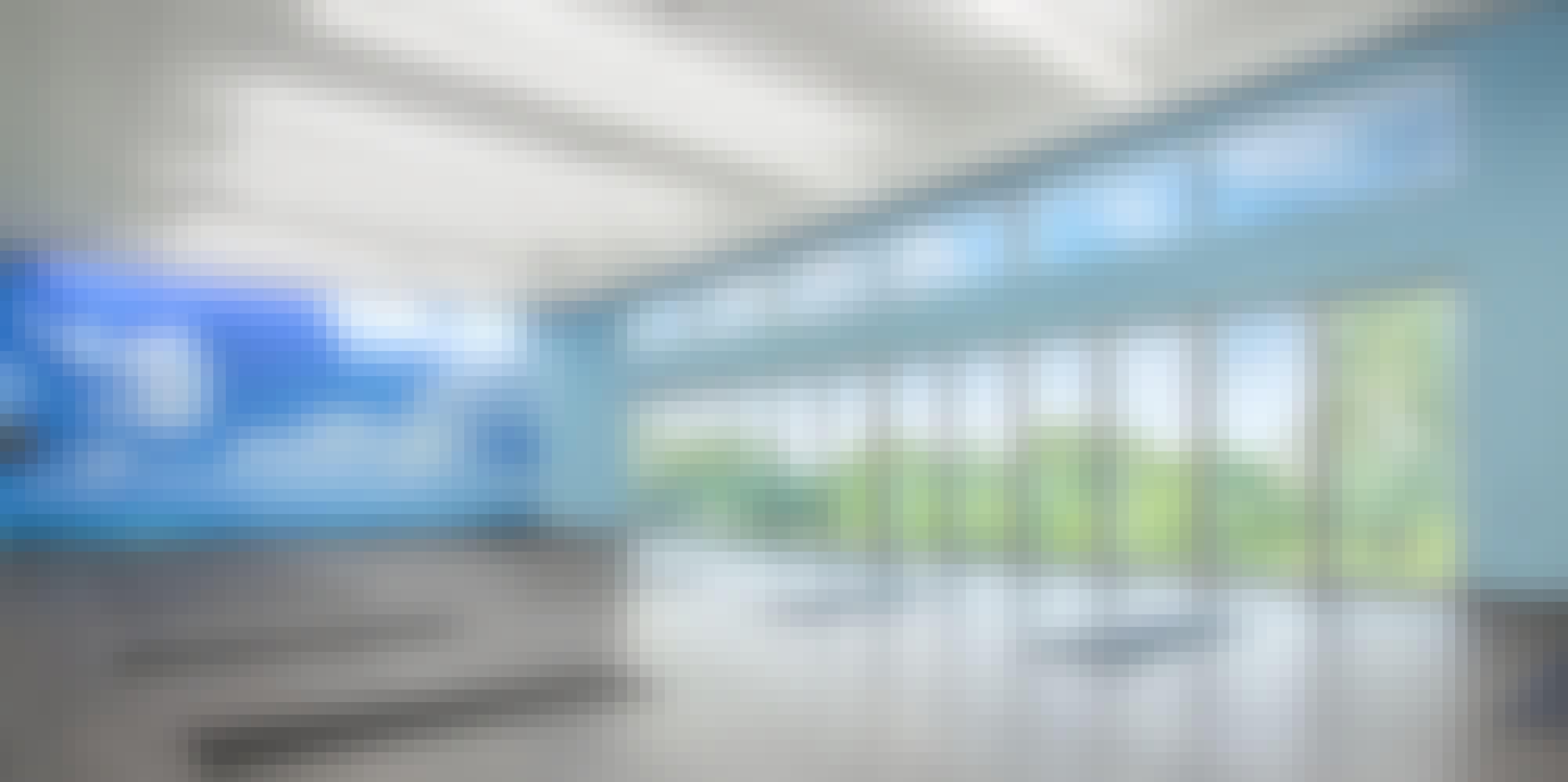 Movati athetlectic facility yoga room with closed folding glass wall