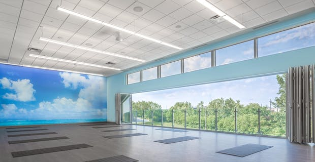 Fitness center design for health and wellness with opening glass walls