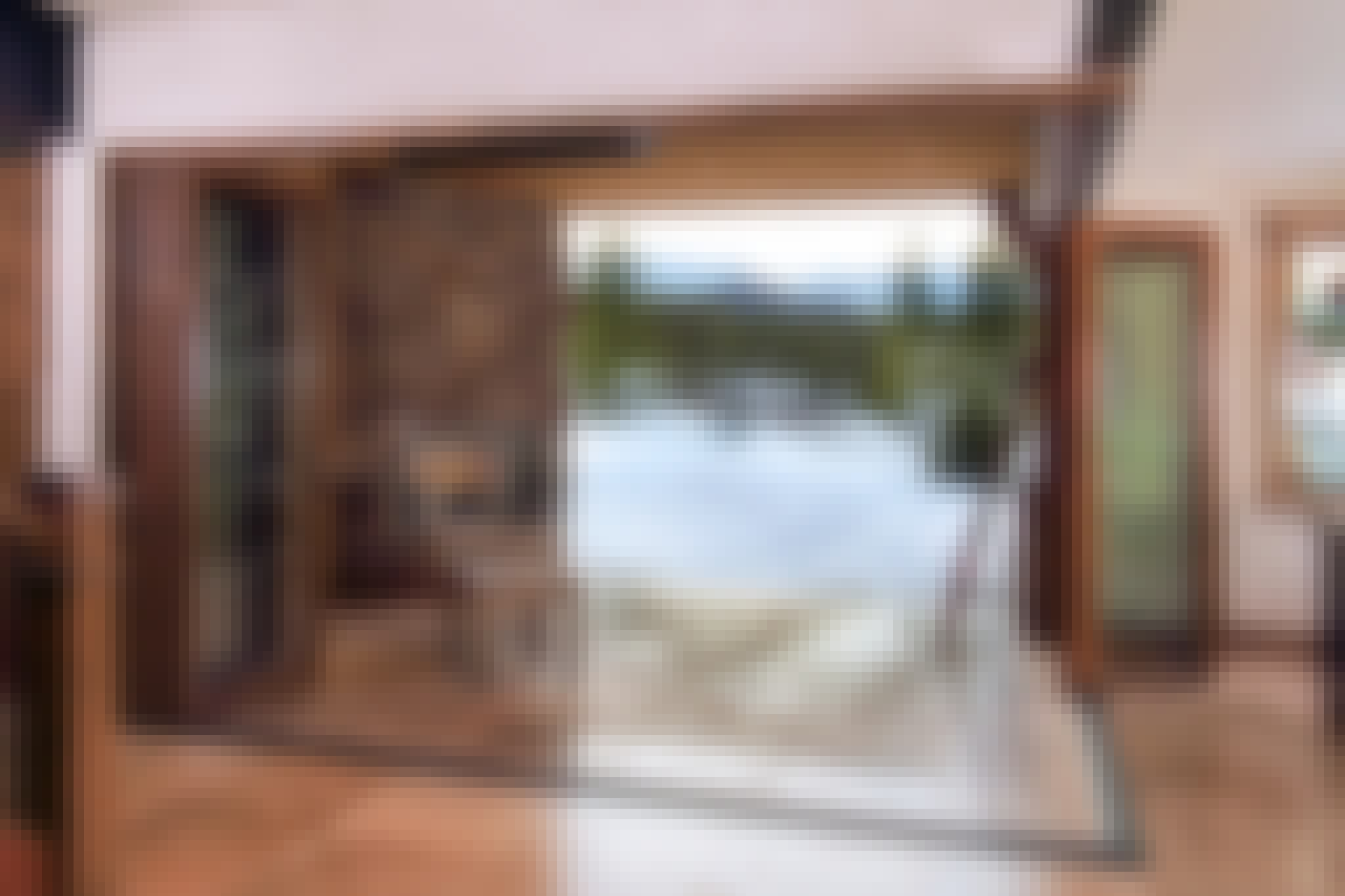 wood framed folding glass wall with open corner design in snow