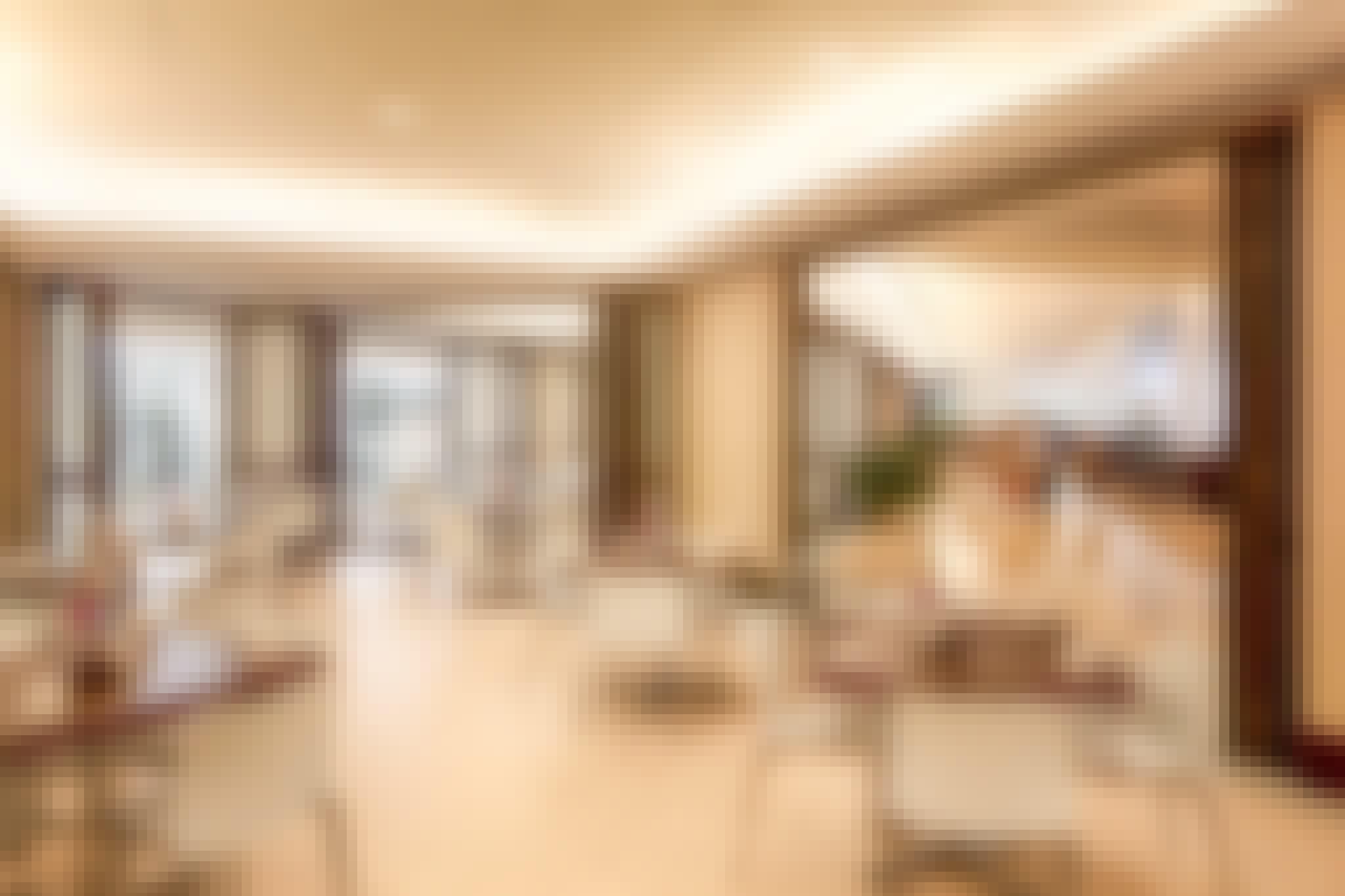 interior commercial glass walls in hotel breakfast area