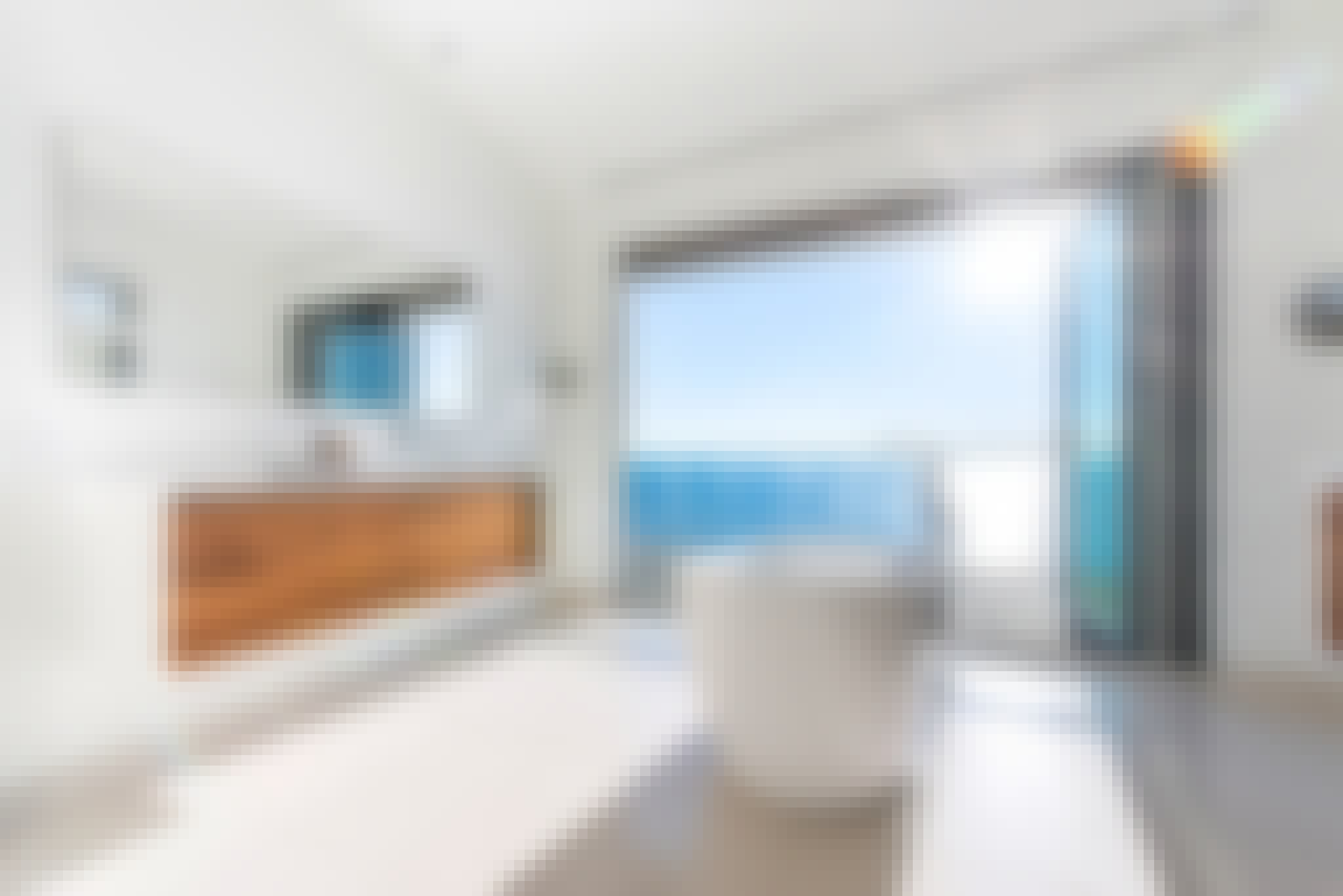 retractable glass walls create bathroom oasis