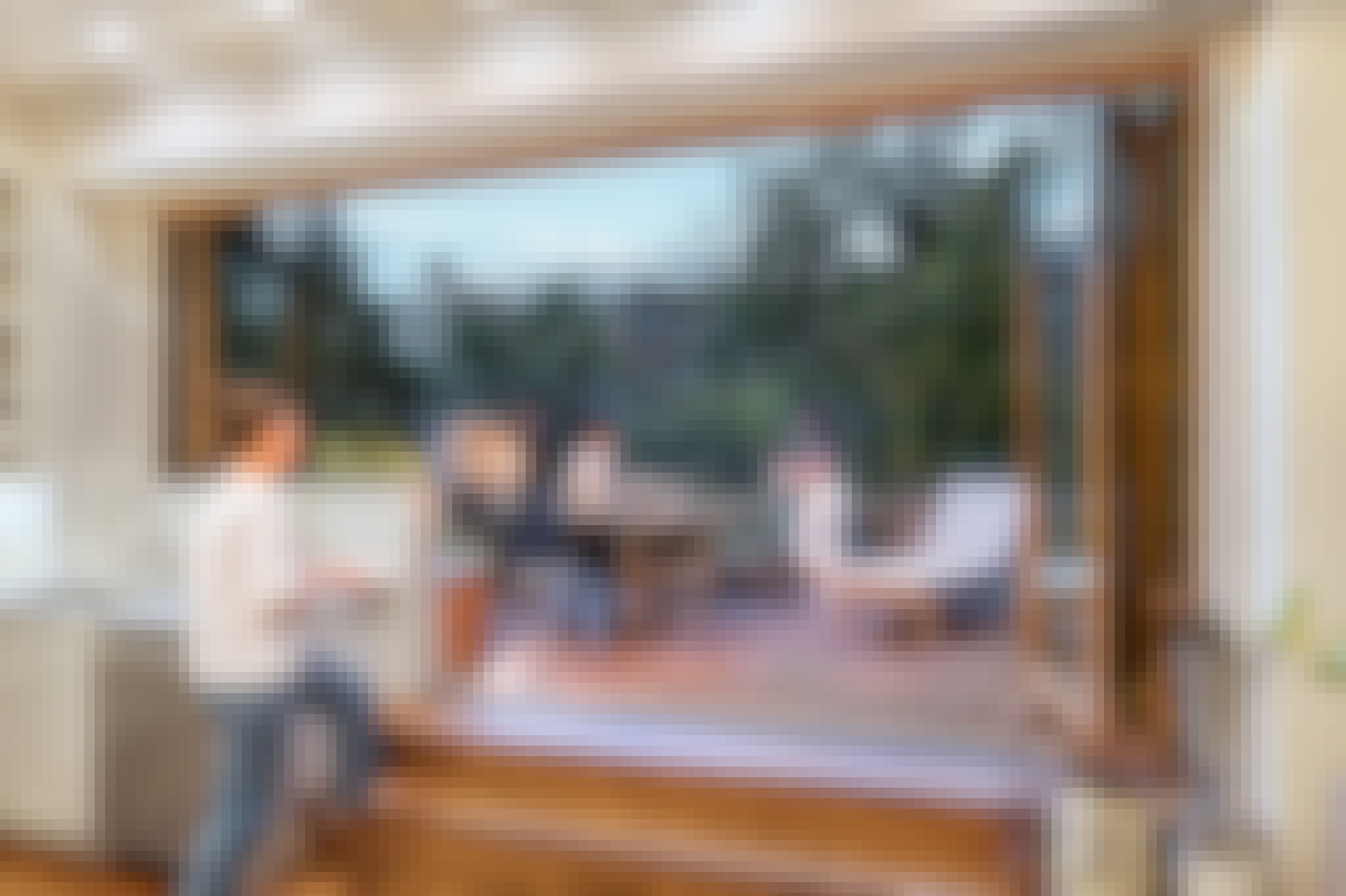 opening glass patio doors open up to a deck