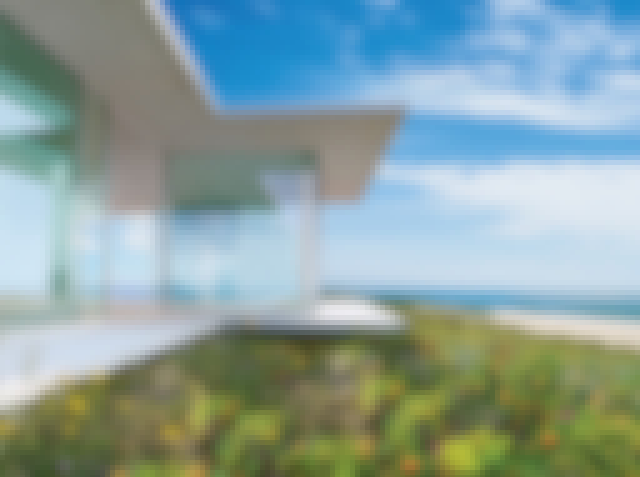 residential glass walls in must see beach house