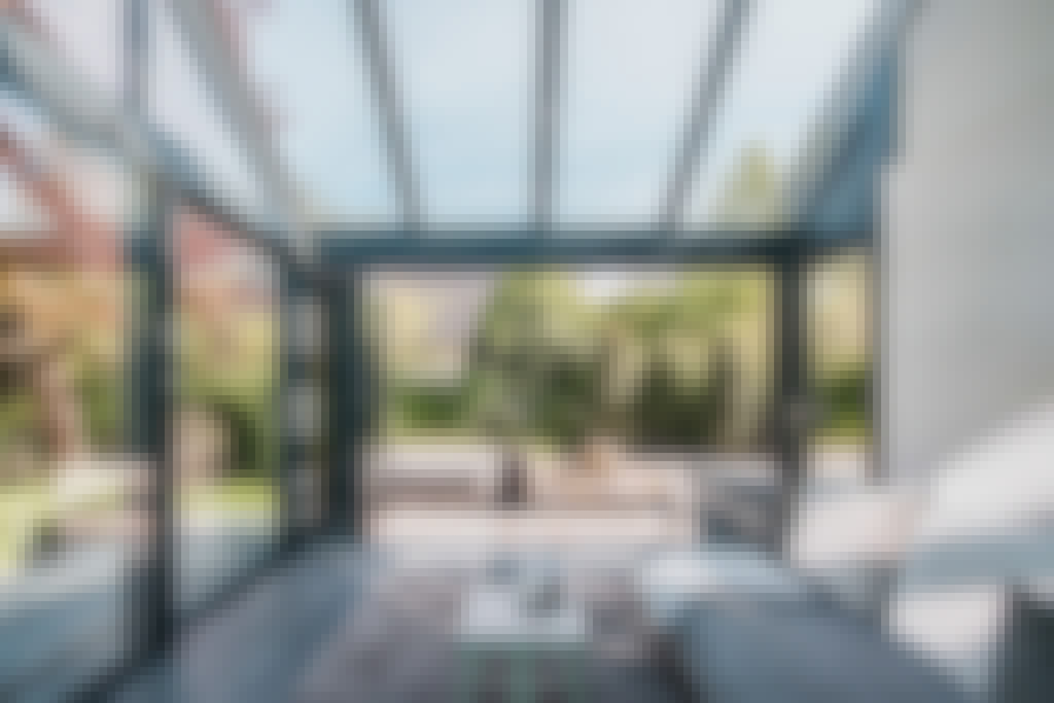 opening glass patio doors in a sunroom