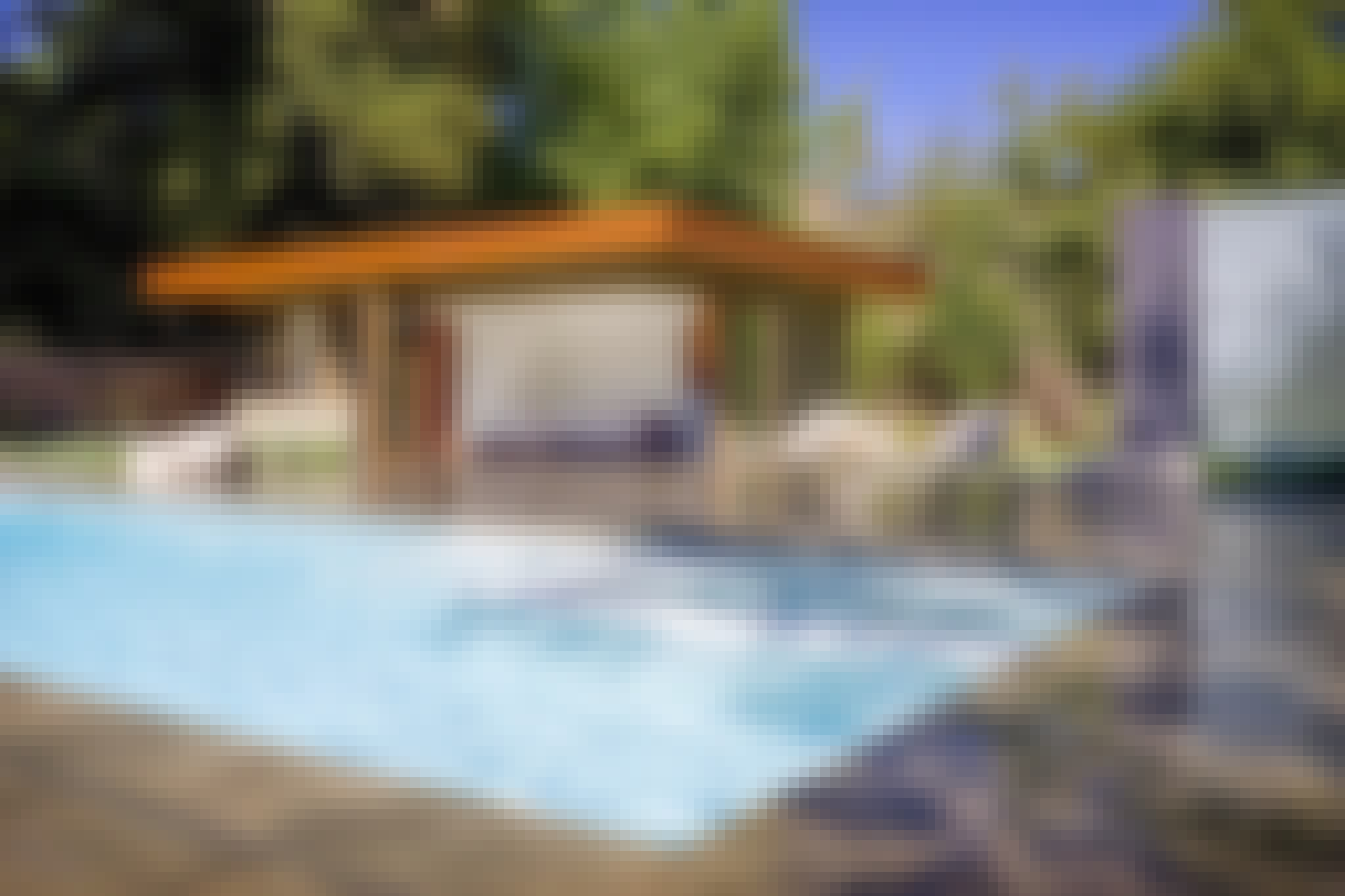 pool house with accordion glass doors
