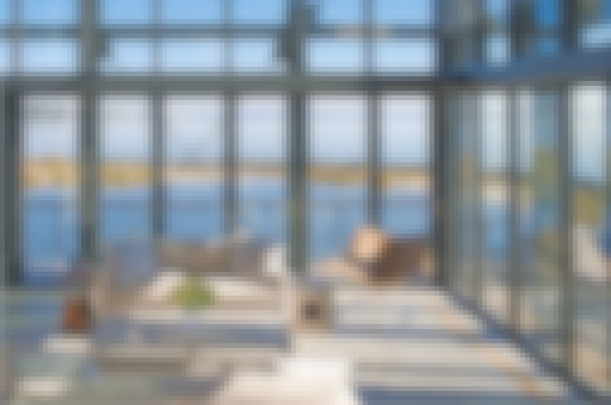folding glass walls systems in beach house design