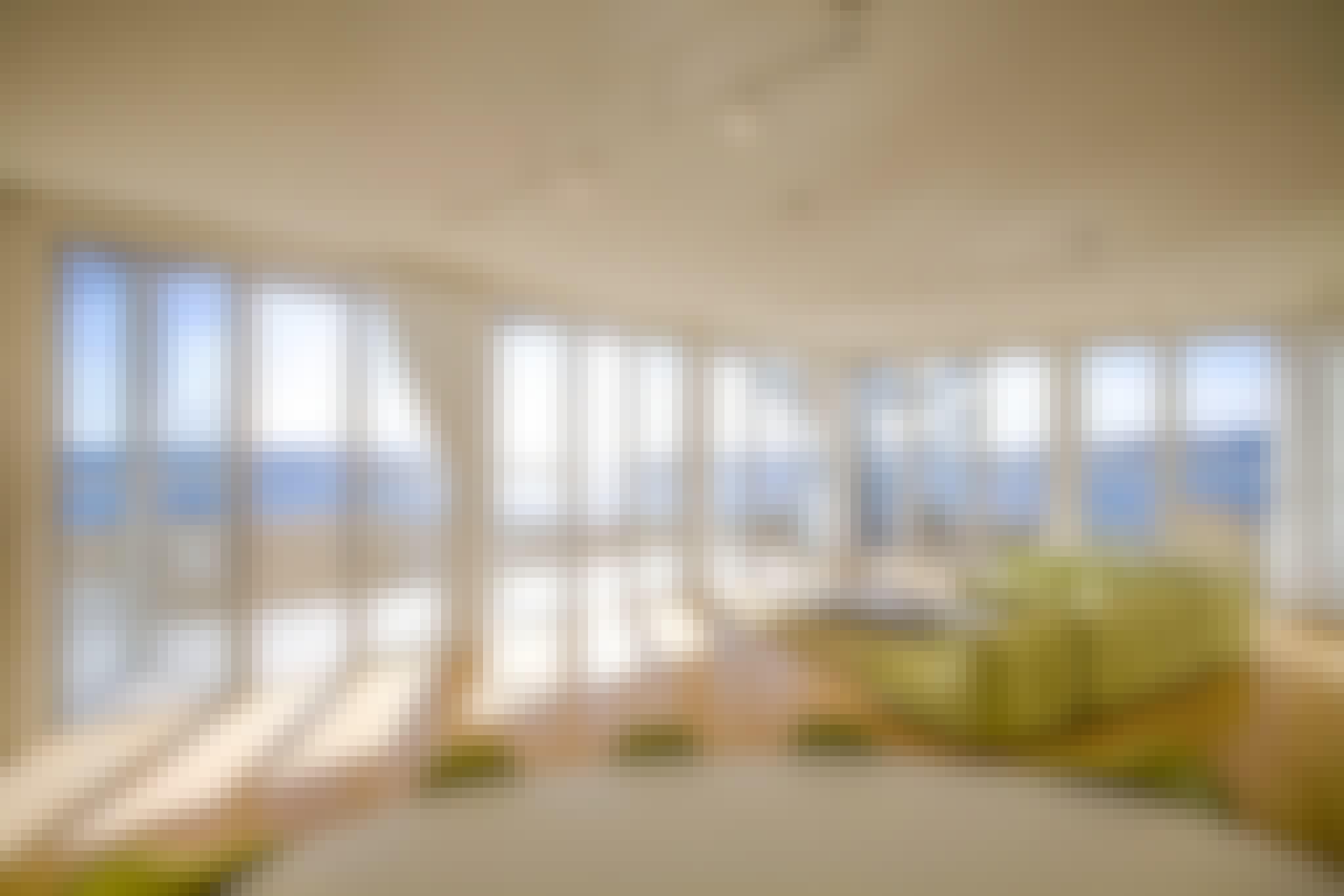 panoramic views through residential glass walls