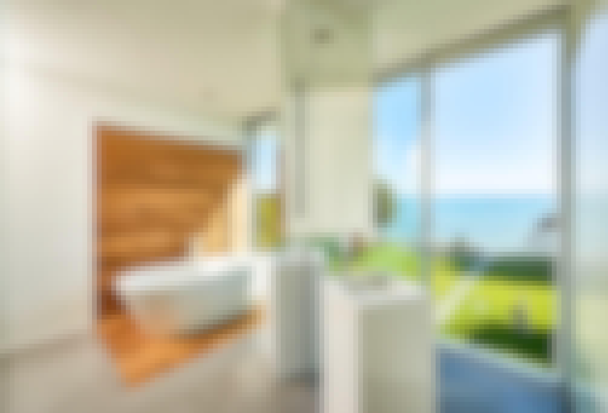 minimal framed retractable glass doors in bathroom