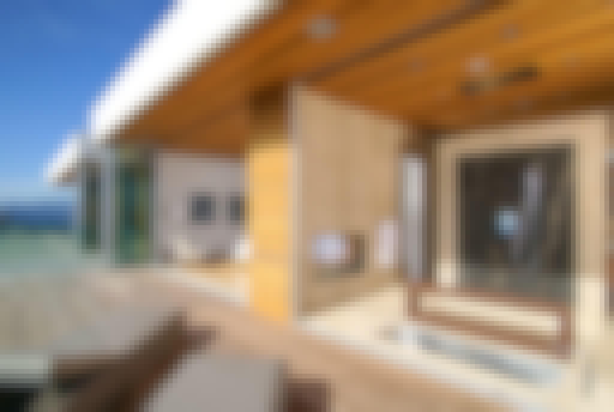 retractable glass doors create indoor outdoor bathroom