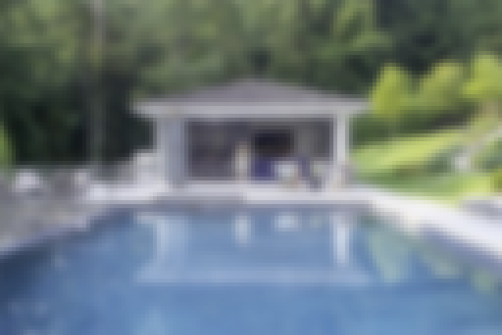 NanaWall folding glass wall systems in pool house design