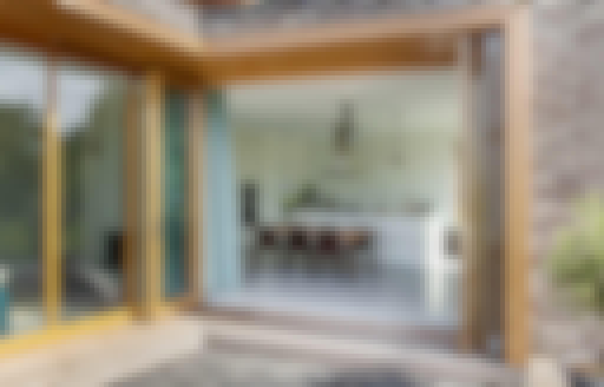 wood framed folding glass doors in modern homes