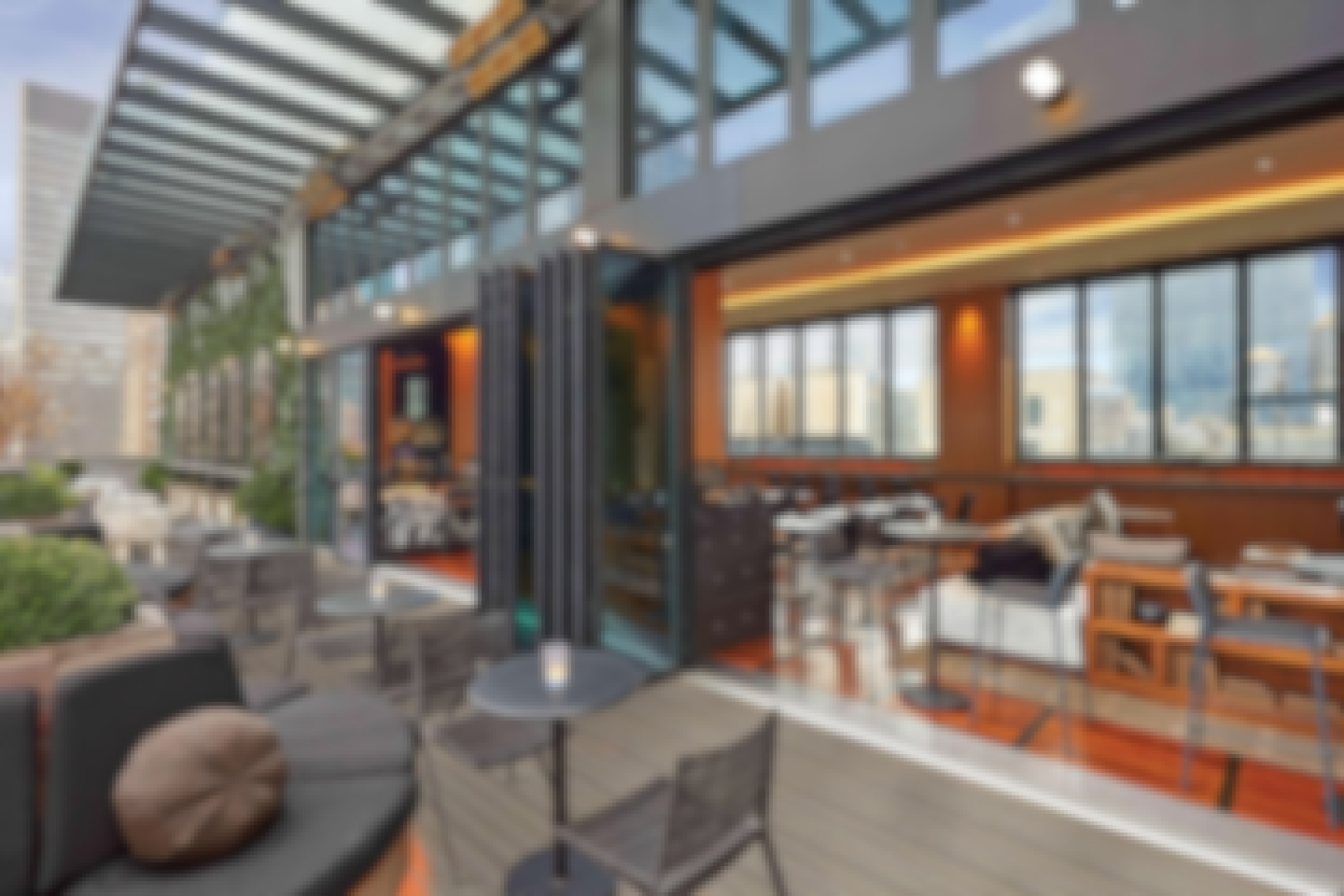 rooftop-bar-with-opening-glass-wall