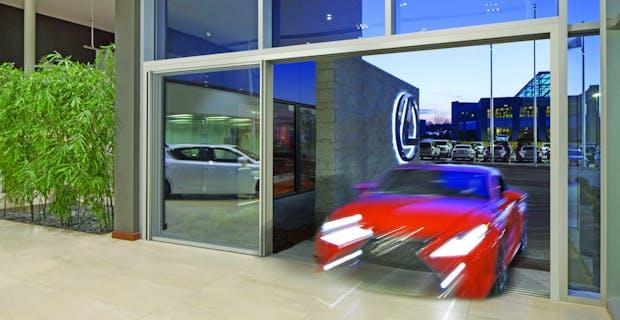 Commercial Glass Sliding Door systems -Lexus dealership cero glass panel exterior door