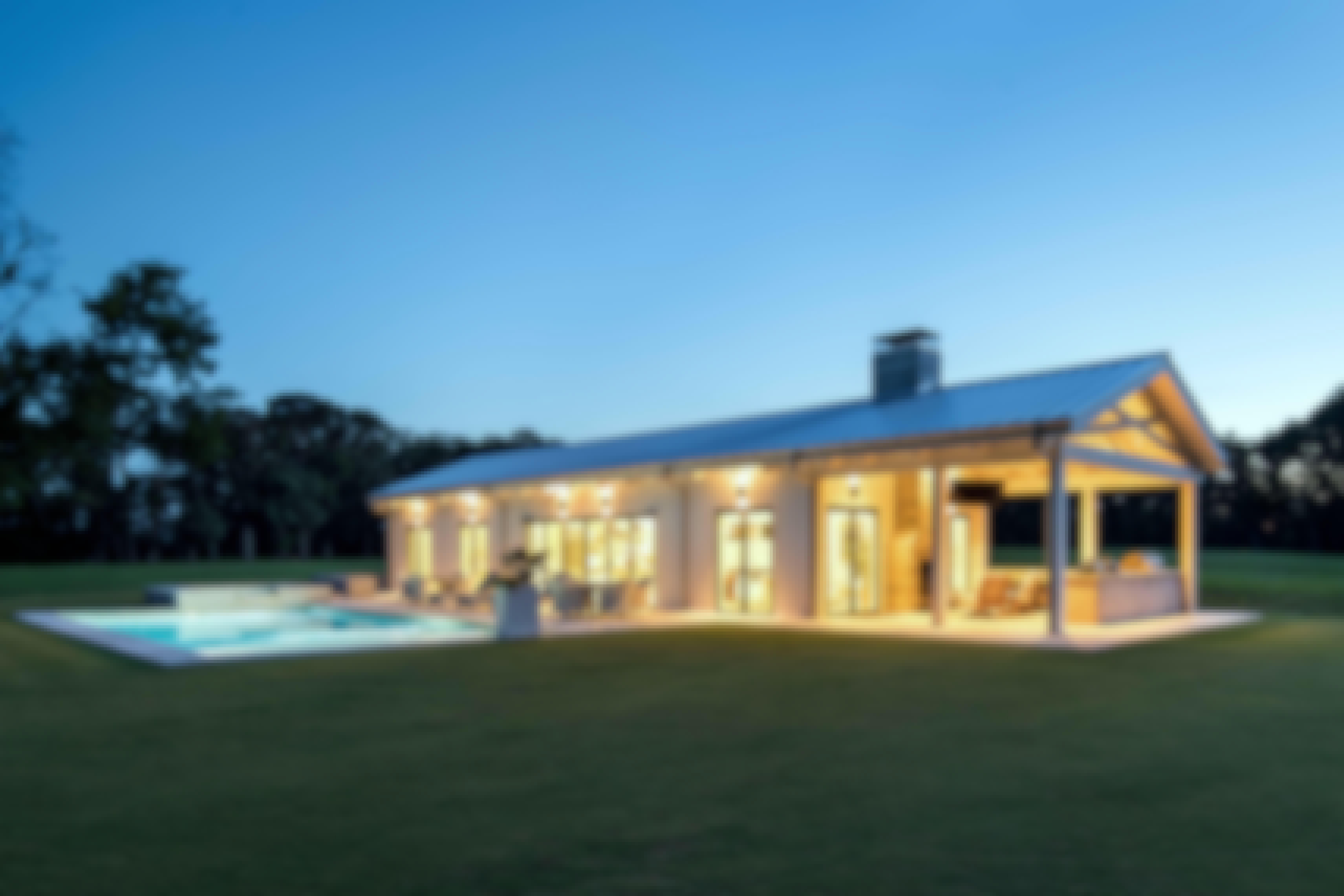 illuminated-pool-house-with-NanaWall-folding-glass-walls