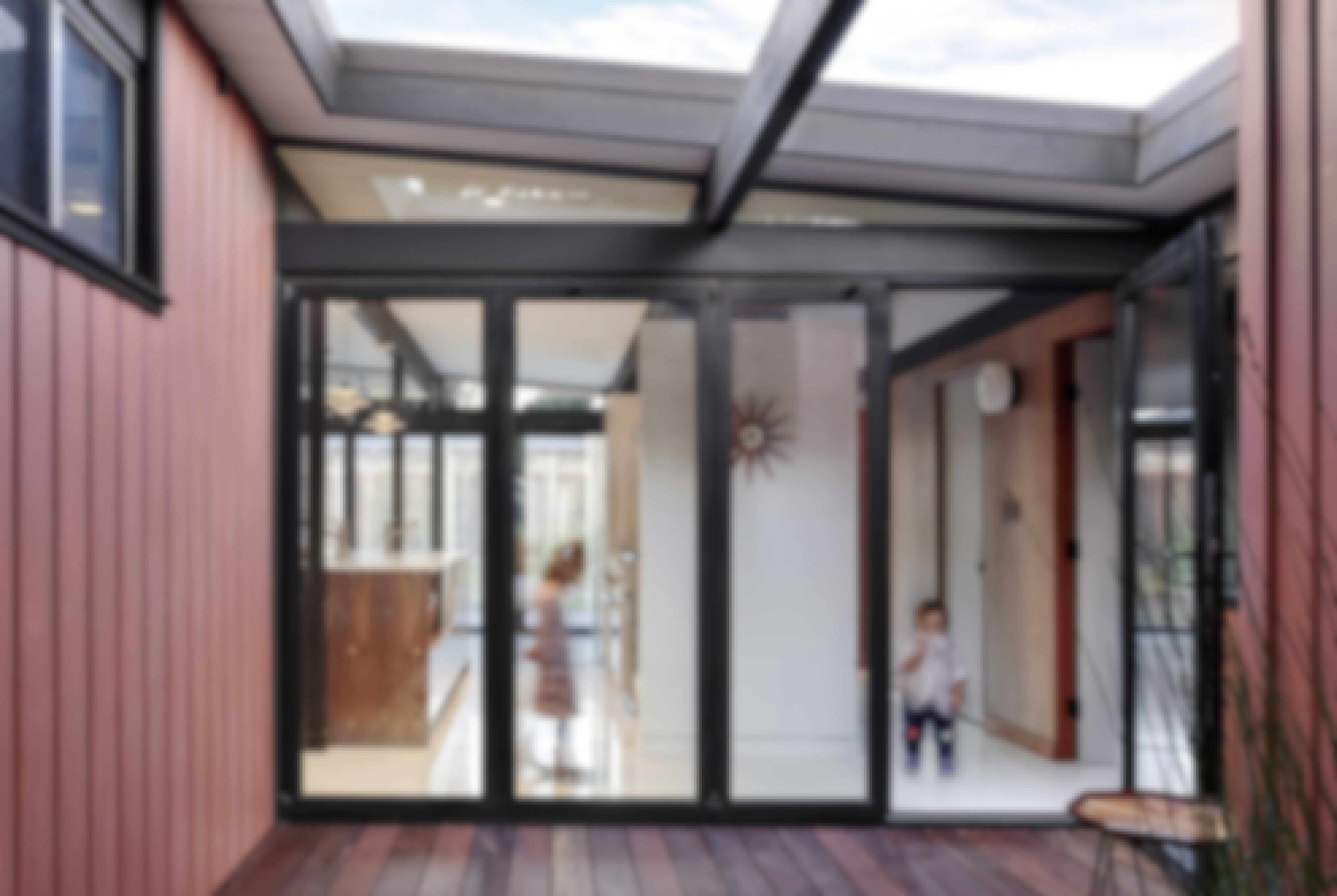 kids-behind-opening-glass-walls