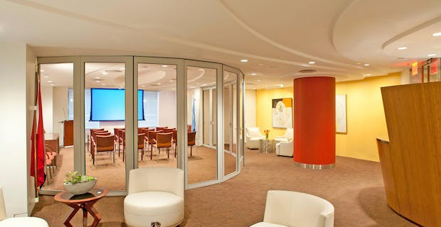 waiting room with segmented curve sliding door system creates flexible reconfiguarable office space