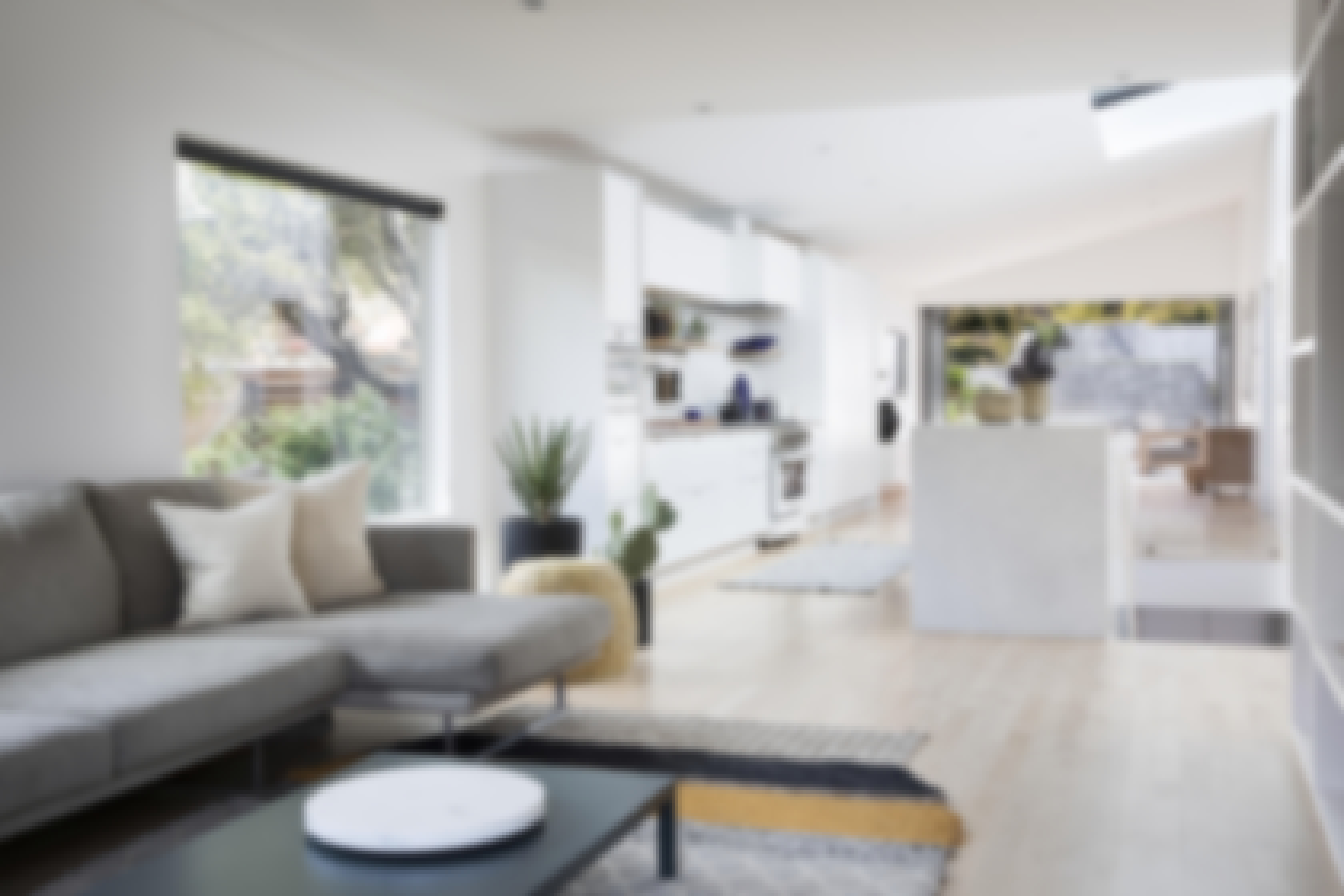 long-open-floor-plan-with-opening-glass-wall millennial home buying trends