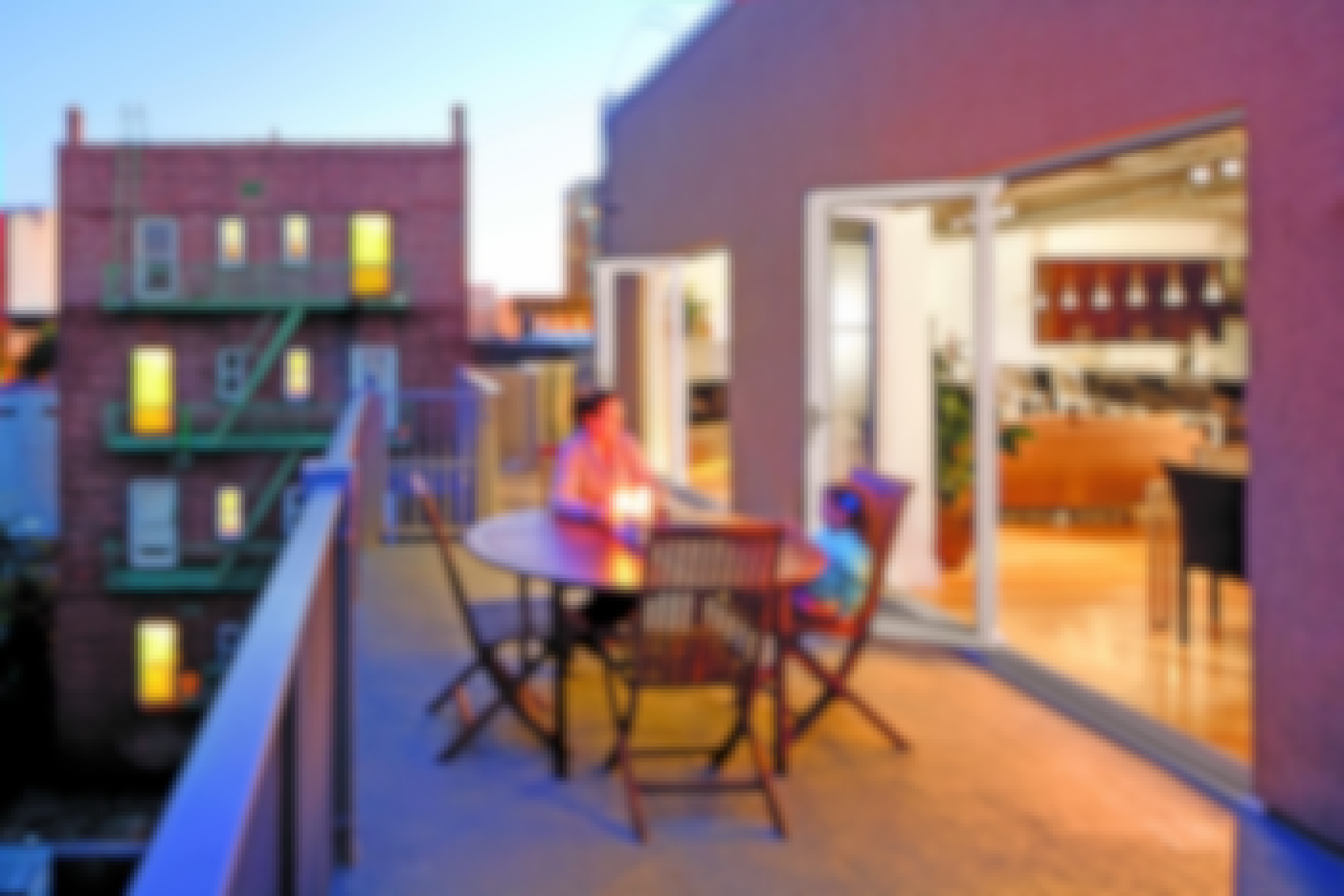 urban-multifamily-residential-deck-with-glass-walls-and-mother-and-child