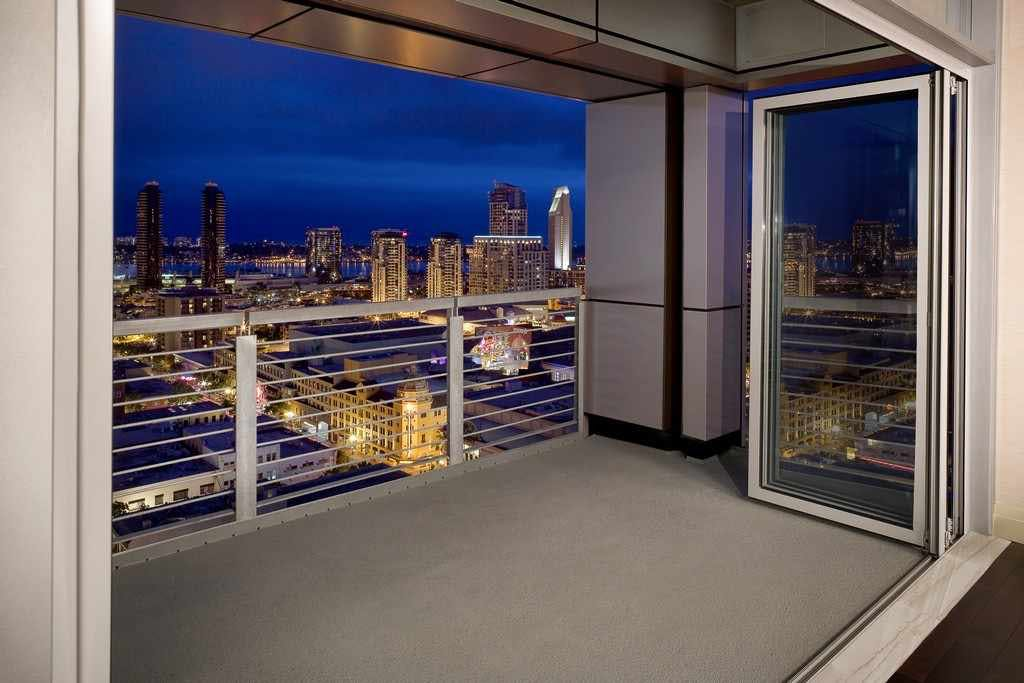 folding-glass-doors-in-multifamily-building-design-open-to-deck