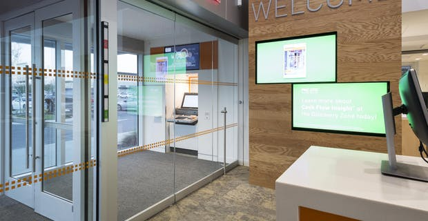 bank branch interior area with frameless opening glass doors
