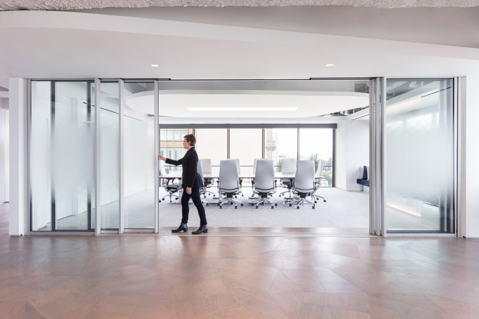operable-commercial-interior-glass-door-in-the-workplace