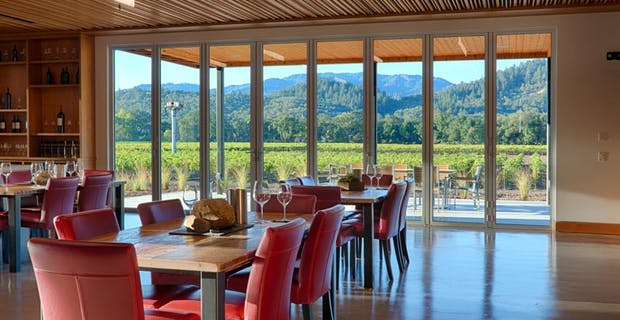 winery interior with commercial glass walls brings the vineyard outside in