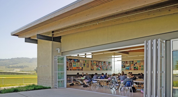 acoustic moveable glass walls allowing air flow and natural daylight to interior school design