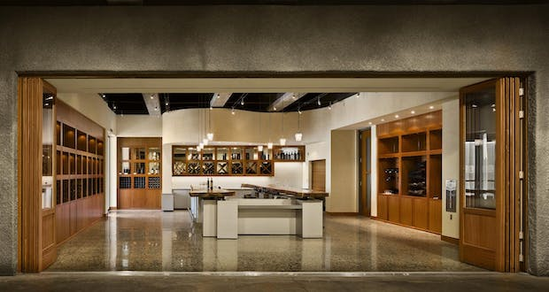winery storefront with  wood framed moveable interior glass doors to regulate traffic flow