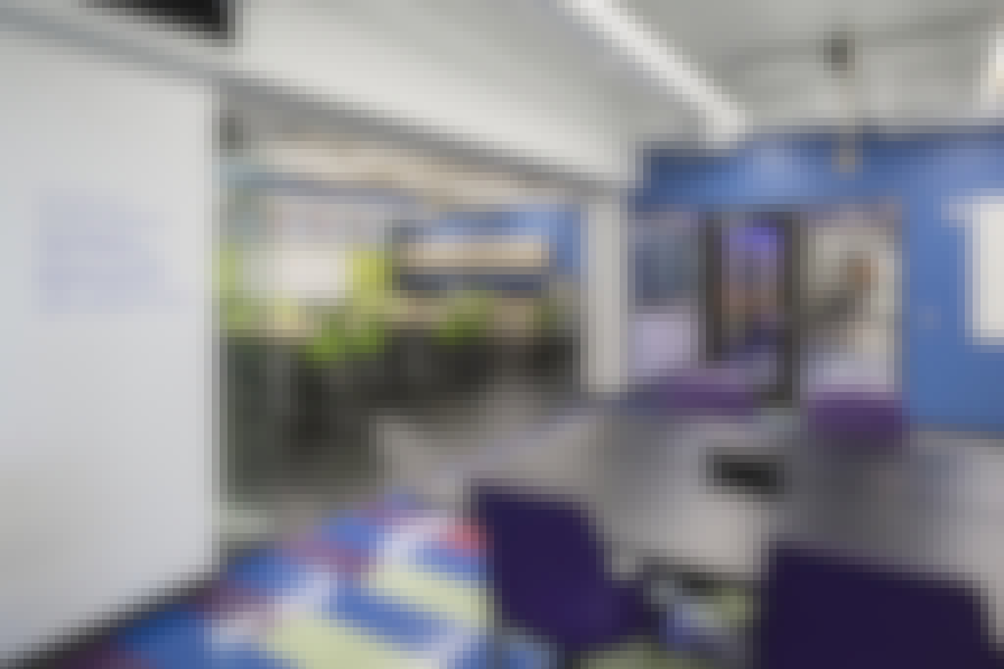 sound caontrol interior frameless glass wall systems between classrooms.
