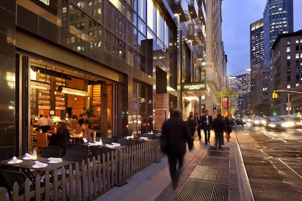 Hotel-Restaurants Exterior with folding door open to NYC street