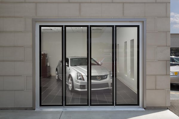 auto showroom exterior with closed commercial glass sliding door system