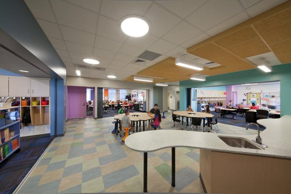 21st Century classrooms joined with acoustic moveable glass walls to form flexspace for collaboration