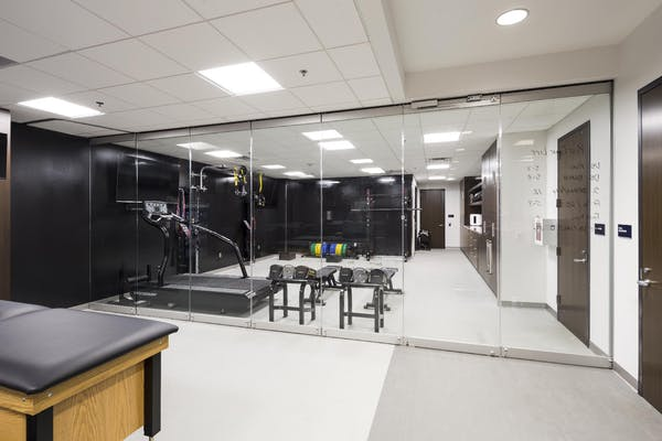 commercial interior glass walls partitions offer sound control and flexibilityn in sports training facility