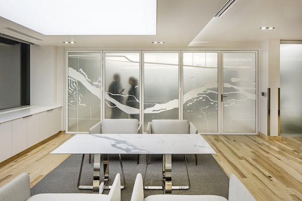 Moveable Interior Glass Walls Providing Sound Control and privacy while to people meet