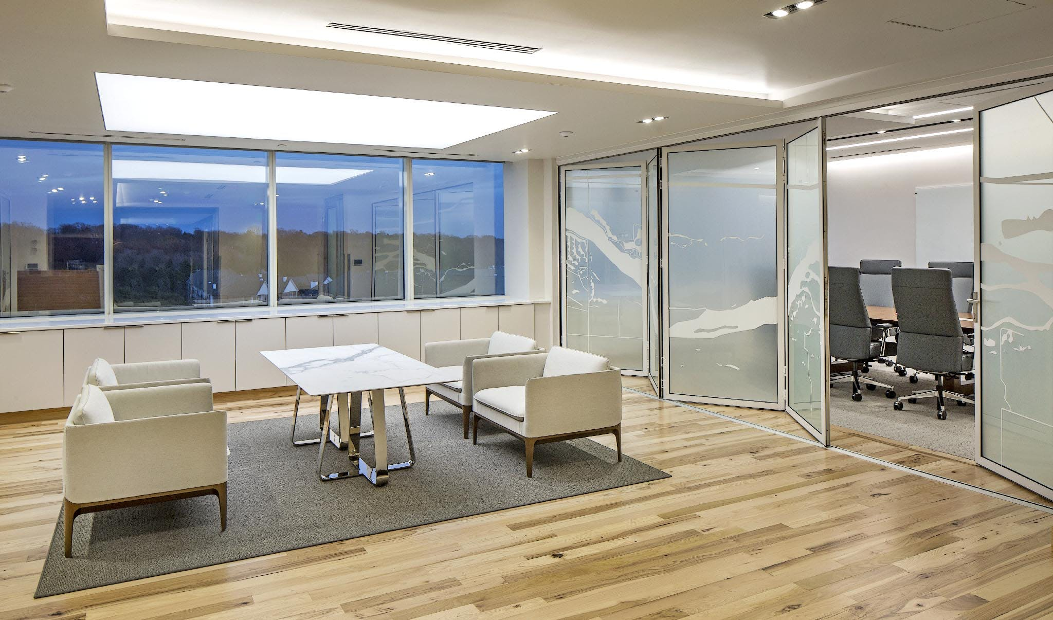 folding interior glass wall system in law office for flexibility between conference room and lobby
