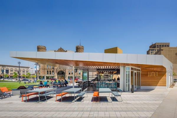 sliding commercial patio door system opened to create indoor/outdoor restaurant exterior